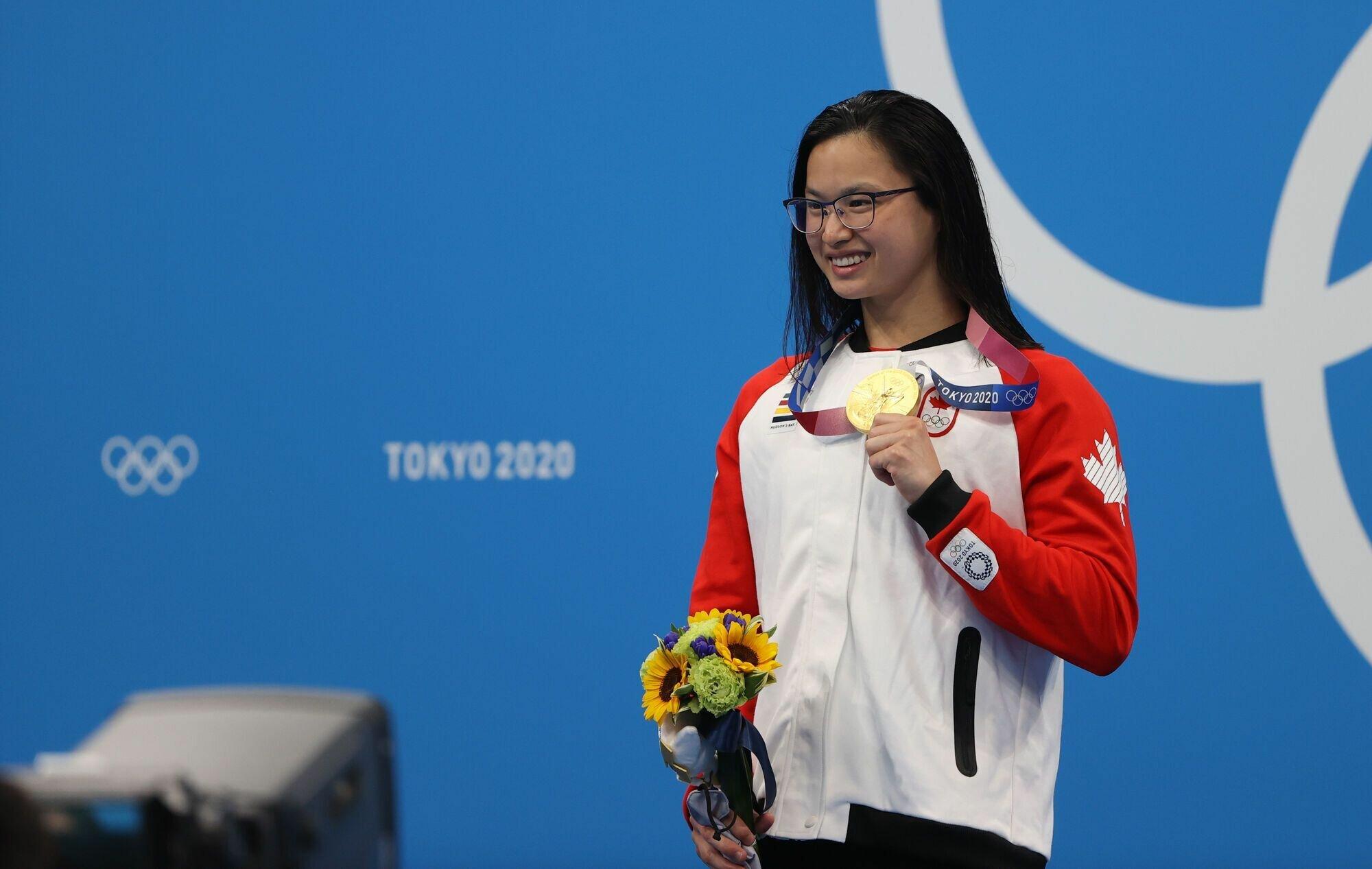 Маргарет Макнил с золотой медалью.