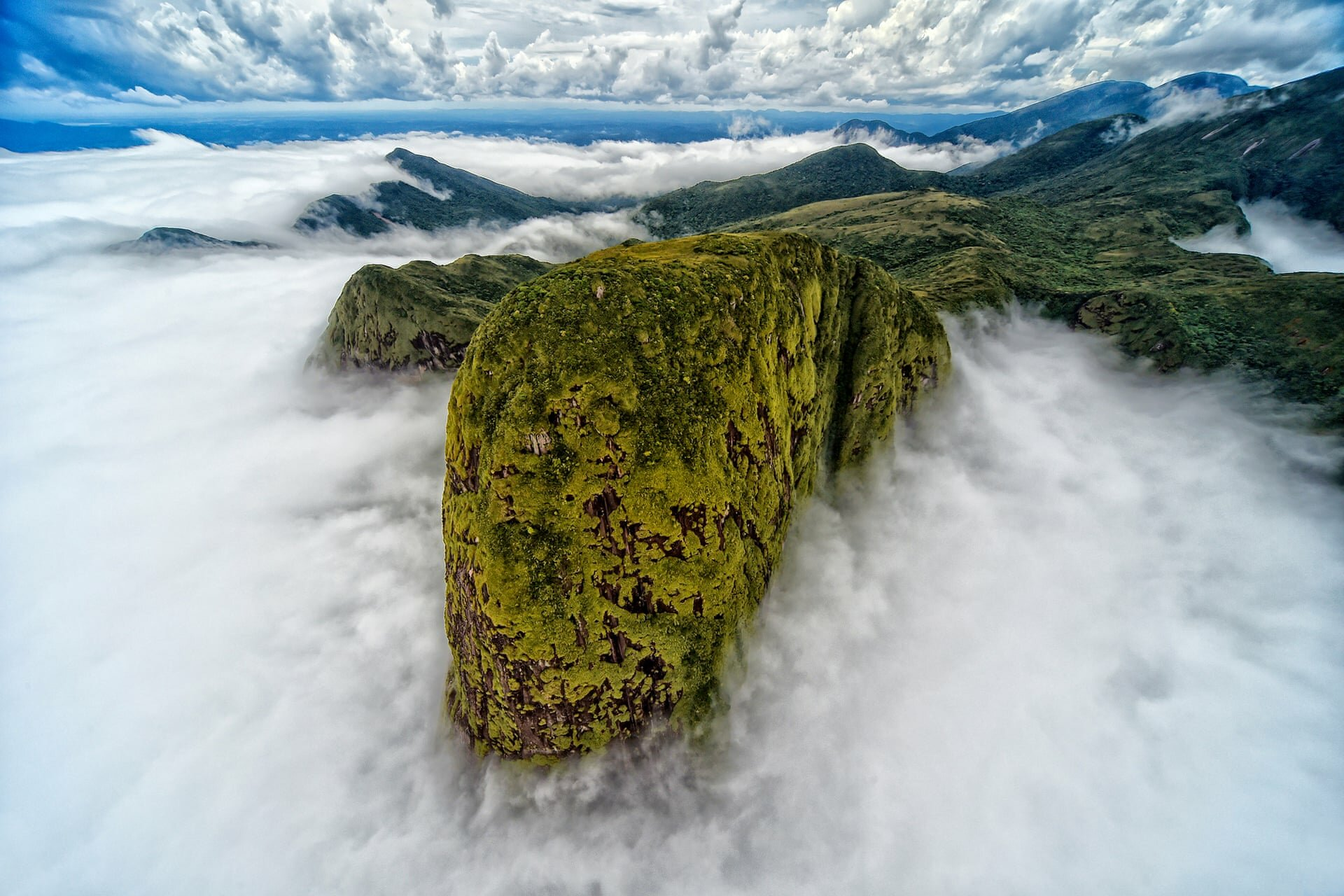 Landscape second place: Denis Ferreira Netto, Brazil'In a helicopter flight through the sea mountain range, I came across this white cloud cover, which resulted in this magnificent image that resembles the head of a dinosaur,' the photographer saidPhotograph: Denis Ferreira Netto/TNC photo contest 2021